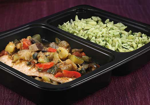 Magic Kitchen meal of salmon with vegetables and orzo, in the microwavable container it would be sent in.