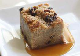 Cinnamon Raisin Bread Pudding with Caramel-Rum Sauce